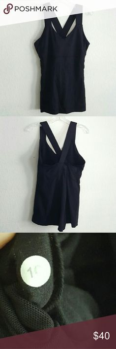 Lululemon Cross Strap Tank *Please do not bundle we will cancel the order of bundled with our discount* No trades, for offers use the offer button* Gently washed and worn. No rips or stains that I can see. Built-in shelf bra. Thick straps cross in the back. lululemon athletica Tops Tank Tops