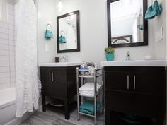 As seen on Flipping the Block...Black Team: Master Bathroom, After. The only bathroom with double vanities, this bright, modern bathroom now feels spacious. White tiles, a soft gray color palette and chrome accessories contribute to its airy feel.