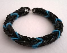 A Fishtail loom bands bracelet in black with a small hint of blue. Loom Band Bracelets, Loom Bands, Fishtail, Jewellery, Leather, Blue, Rubber Bands, Jewels, Schmuck