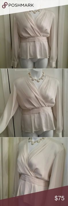 """Stunning cream blouse Incredible cream blouse from the high end """"Collection"""" line of Jones New York  Size 14W Beautiful subtle sheen material with delicate pebble pattern Slimming style drapes your body beautiful  Ruching to hide tummy Hidden side zipper for perfect fit, pull on over head Wrinkle resistant polyester material  Cream button on cuffs 24 inches long 24 inches across armpit to armpit lying flat  The Silver/Platinum one is also available in my closet Jones New York Tops Blouses"""