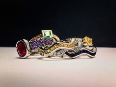 Selection of gemstone and 18k gold rings by Ian Davidson.