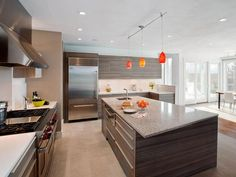 Dark cabinets, but not too dark. This could be interesting for our kitchen. Modern Kitchen Design and Appliances