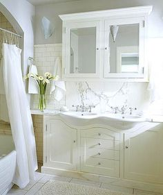 Space-Saving Vanity Ideas- This is a perfect example of how shallow bathroom vanities can save space. Combined with standard-size sinks, they create a great look without sacrificing style or much storage space. Note how the arched shape of the vanity is echoed in the opening of the shower.