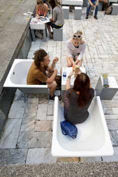 In 2010 Art Pit turned an abandoned fountain of Soviet Union time in Jaunas (Lithuania) into Art Square, a temporary community pool for recreational activities. The furniture and lighting by Justina Balčiūnaitė and Jonas Juozas Rudzinskas were made of repurposed old baths and water­proof mater­i­als.