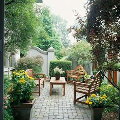 ✤ Landscaping Ideas for Privacy #5 - An Artful Fence Distinctive features play up the elegance of a private patio. Most every fence needs edges and cap pieces; here an edge shaped into a curve and a cap piece in the form of a pyramid offer visual accents.