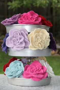 up-cycled cake pans into cake stands  with felted wool rose pins by Isa Creative Musings
