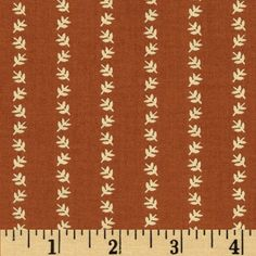 Designed by Char Hopeman for Troy Corporation, this cotton print fabric is perfect for quilting, apparel and home decor accents. Colors include warm red and cream.