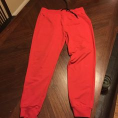 Red joggers Bright red joggers / sweats. Slight pilling on inner thigh area. Pants