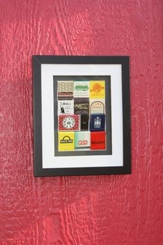 Framed matchbook collage.  I'd leave a little more space between them.
