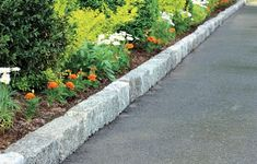 Adding a neat row of Belgian block stones to each side of an asphalt driveway will boost its curb appeal while also providing a clear visual aid as you back out or pull in<br> Asphalt Driveway, Stone Driveway, Circular Driveway, Cobbled Driveway, Landscape Curbing, Landscape Edging, Garden Borders, Garden Paths, Garden Bed