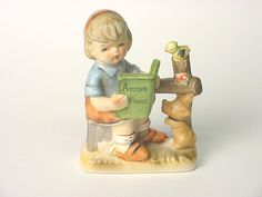 1980? Porcelain figurine of a young girl reading Aesop's Fables to a dog and a bird