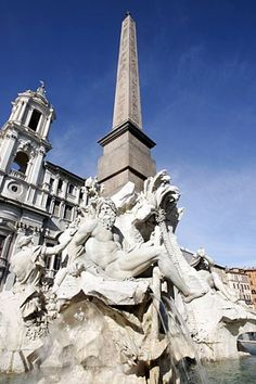 Rome, Italy--Sant'Agnese in Agone looms over the Fountain of the Four Rivers in Piazza Navona.