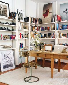 This is a comfortable office that has lots of open storage and artwork for inspiration.