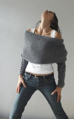 This actually looks like the sweater is up-side down ... but the neck would have been enlarged or simply cut across- from shoulder to shoulder!