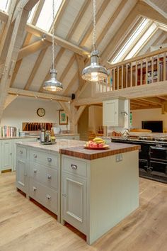 This beautiful Neptune Kitchen was designed by Distinctly Living of Dartmouth and expertly fitted into this wonderful Carpenter Oak kitchen/diner extension. Edwardian House overlooking River Dart, Devon. Colin Cadle Photography, Photo Styling Jan Cadle