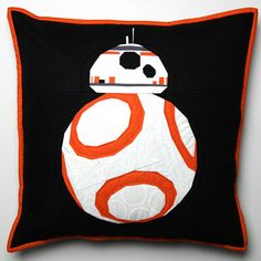 Loving this sweet little BB-8 cushion by Mary Emmens from Handmade by Mary Emmens! She made him as a gift using Robert Kaufman Fabrics Kona solids and a foundation paper piecing pattern by Vanda Chittenden from Fandom In Stitches. The bold contrast with the black background is so striking, and her simple quilting with Aurifil lets the piecing really shine! For more details, please visit: http://mary.emmens.co.uk/2017/01/23/ive-still-never-seen-star-wars/