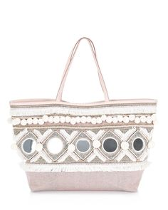 Embellished with beads, mirrors and pom-pom trim, this canvas tote from Rebecca…
