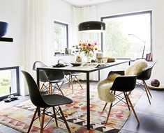9 Must-Haves for a California Eclectic Home// sheepskin throw, modern dining chairs