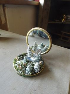 have taken this delightful antique mirror compact and placed a beautiful winter wonderland scene in to it , a real beautiful item to give this Xmas