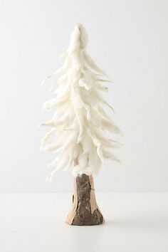 Anthropologie felt tree, I'm thinking could be done with chunky wool, and some kinda glue mixture