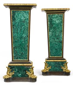 A pair of Louis XIV style ormolu-mounted malachite and ebonized pedestals probably Russian, second half 19th century height 50 1/4 in.; width 22 in.; depth 14 in. 128 cm; 56 cm; 36 cm