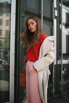 Desi is wearing res jumper, pink cullotes, Céline soft ballerinas, Simon Miller bag, Sandro coat.