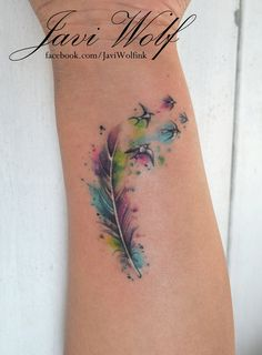 Watercolor feather. Tattooed by @Javi Wolf