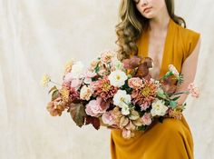bountiful fall inspired bridal bouquet with amazing peach, pink, orange, white and yellow flowers