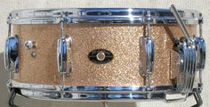 Slingerland Radio King snare drum made from a single ply of solid steam-bent maple.  Used on more rock records than any other snare.  Champagne Sparkle.