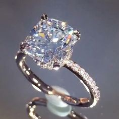 OF COURSE SHE SAID YES!!!!! A cushion cut beauty..... From @LAUREN B JEWELRY AND D