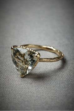i want this. NOW.  -- BHLDN - Woodland Sun Ring $480.00  http://www.bhldn.com/the-shop-jewelry/woodland-sun-ring or Evergreen Hollow Ring $770.00 http://www.bhldn.com/shop-the-bride-bridal-jewelry/evergreen-hollow-ring?upsell=1  designer alex monroe