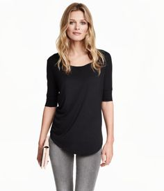 Top in soft, gently draping jersey with slightly longer short sleeves and a rounded hem.