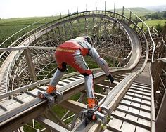 Oh My Gosh. People actually do this? Skating a coaster. Trips Drill Theme Park, Stuttgart, Germany.
