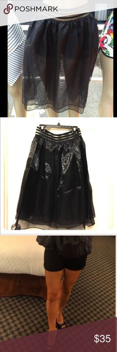 NEW no tags sheer black skirt with shorts attached stretchy shorts , I have one size S and one size M left ; 2 layered skirt,first layer 23 inches from top to bottom , second layer is 25 inches from top to bottom.  Insta model T shirt available in @erikagannon Poshmark closet 🌟REASONABLE OFFeRS ACCEPTED🌟 Skirts Midi