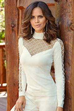 This distinctive sweater has a sheer mesh decollete and sleeves enhanced with lattice detail that's sprinkled with bugle beads and crystals. Banded cuffs and hem.• Rayon/nylon.• Imported.• Hand wash.• Fearlessly fitted: very shaped, fits close to the body.• Sizes XXS(0), XS(2-4), S(6-8), M(10-12), L(14-16), XL(18).• Ivory, proper black, brilliant cobalt, heartthrob, emerald city.