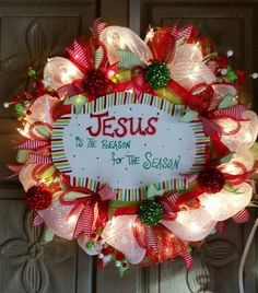 "This is a beautiful 24"" deco mesh Christmas wreath.  It is made of red, white and lime green mesh and accented with holiday sprays and decorative ornaments with"
