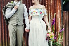 An off the shoulder wedding dress made from embroidered vintage tablecloths...
