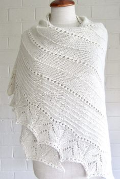 Free Knitting Pattern for More Simple Lines Shawl - Triangular shaped shawl with a lace border framing a body textured with eyelets and purl rows. Worsted weight yarn. Designed by maanel
