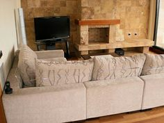 Huge sofa, large & flat TV screen and a chimney. The perfect chill out compilation! Simply ask us to put the music!