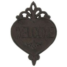 """Hang thisDark Brown Cast Iron Welcome Plaque above your door or on your porch for a warm, rustic greeting! This simple but charming piece features a heart shape with flourish accents, along with raised text. Display it near the entrance of your home and greet guests in style!        Dimensions:      Length: 7 3/8""""    Width: 5 3/8"""""""
