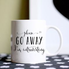 """Coffee mug reads """"Please go away I'm introverting"""" The perfect gift for that introvert in your life. Or get it for yourself and drink alone while reading a book. This listing is for a white 11oz mug with black typography reading """"Please go away I'm introverting"""" Back side is blank. Mug is dishwasher and microwave safe. Need your mug fast? https://www.etsy.com/listing/205337135/rush-your-mug Check out my other mugs here: ..."""