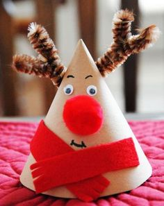 This Christmas rudolph reindeer cone makes a great nightstand companion and adds a cute decoration to your dinner table. Cool Reindeer Crafts for Christmas, http://hative.com/cool-reindeer-crafts-for-christmas/,