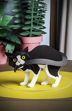 Paper work for Project M Magazine by Katrin Rodegast -- black paper cat biting its tail