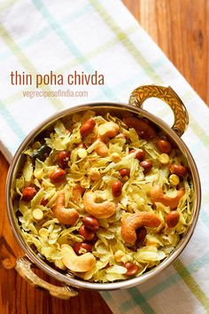 poha chivda recipe with step by step photos. a maharashtrian style quick and tasty snack made from thin poha (flattened rice), dry fruits, peanuts, and spices. this version of poha chivda is made mostly during diwali festival as a savory snack. Veggie Recipes, Indian Food Recipes, Vegetarian Recipes, Snack Recipes, Cooking Recipes, Kerala Recipes, Dry Snacks, Savory Snacks, Yummy Snacks