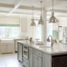 The cabinets are painted in Sherwin Williams Wool Skein (SW6148) with glazing finish and the island is Sherwin Williams Chatroom (SW6171) with a glazing as well.