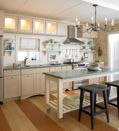 Create a bright  kitchen with cabinetry in Biscotti with Coconut Glaze and warmly lit satina glass doors.