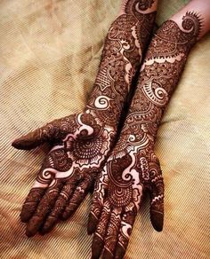 Stylish and fashionable henna mehndi designs and tattoos are in vogue. Check the trending henna designs for hands, wrist, leg and as temporary tattoos too. Dulhan Mehndi Designs, Mehandi Designs, Simple Arabic Mehndi Designs, Latest Bridal Mehndi Designs, Wedding Mehndi Designs, Beautiful Mehndi Design, Latest Mehndi Designs, Mehndi Designs For Hands, Wedding Henna