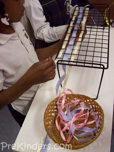"""weaving...dollarama shelf - good fine motor - I think I will set up a basket at the other end to """"receive"""" and the kids can pull the ribbon all the way through and start back again / look at other things to weave too ..."""