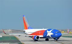 """Southwest Airlines Boeing 737-3H4 N352SW """"Lone Star One"""" turns on to the taxiway at Los Angeles-International, April 2013."""
