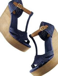 Add leg-lengthening height and laid-back sophistication to any look with Tory Burch's Carina wedge sandal.